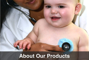 A doctor listens to a young baby using a stethoscope covered with StethoBarrier disposable stethoscope covers.