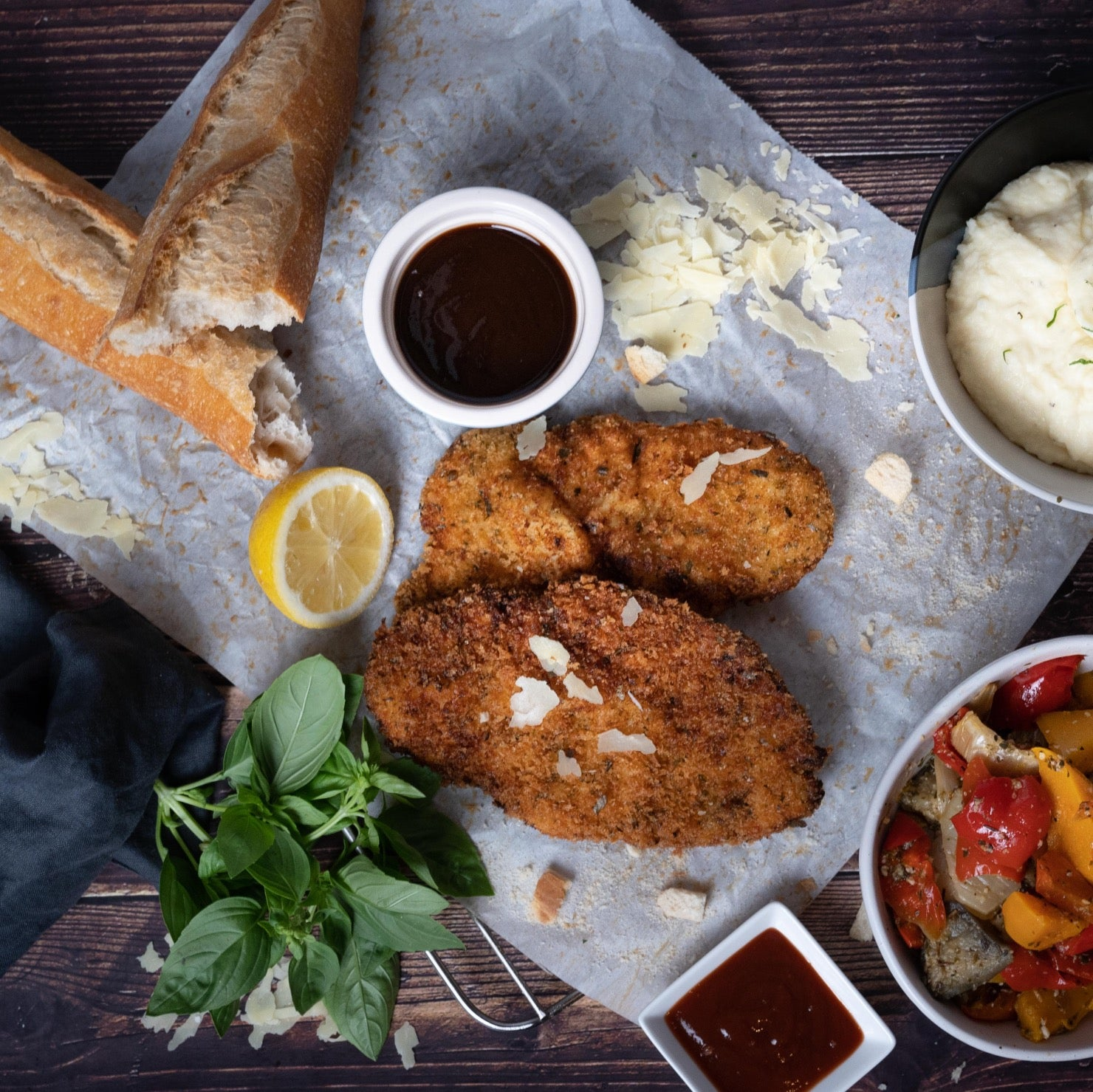 Chicken Schnitzel with BBQ sauce and bread on a flat tray