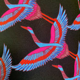 Close up of flying cranes pattern on black background of lampshade