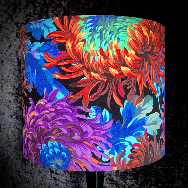 Lampshade with chrysanthemums in rainbow colours on a black background