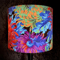 Lampshade featuring rainbow coloured chrysanthemums on a black background