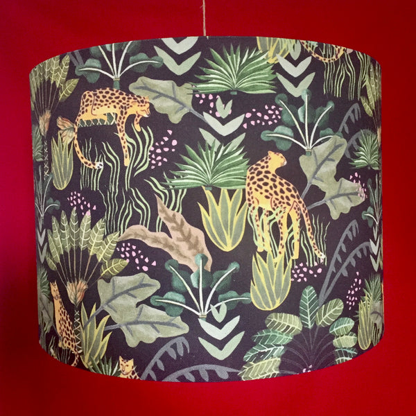 Ceiling shade with leopards and jungle design on a black background
