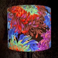 Lampshade featuring chrysanthemums in rainbow colours on a black background