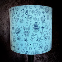 Blue lampshade with tattoo flash designs