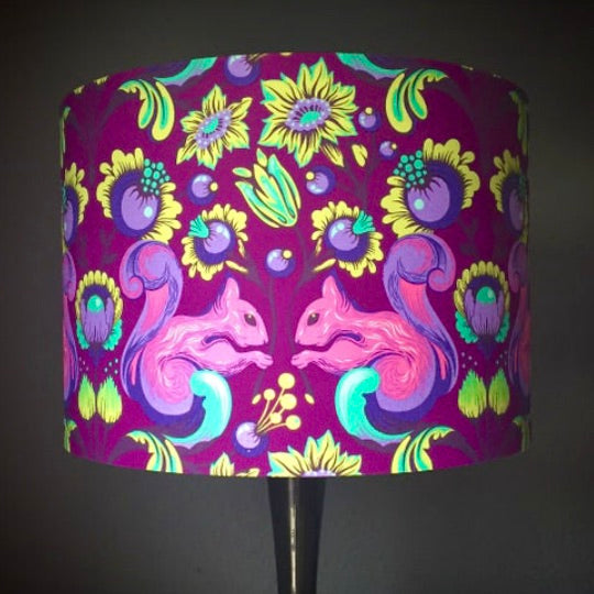 Handmade lampshade featuring pink squirrels on a purple background with lime green flourishes