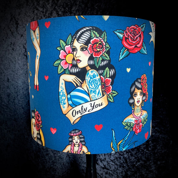 Blue lampshade with tattoo flash images of pin-up girls, roses, hearts and dice