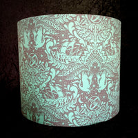 Jade green lampshade featuring ships, storks and a starry night sky