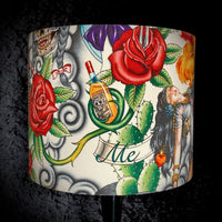 Lampshade with roses and tequila bottle on cream background