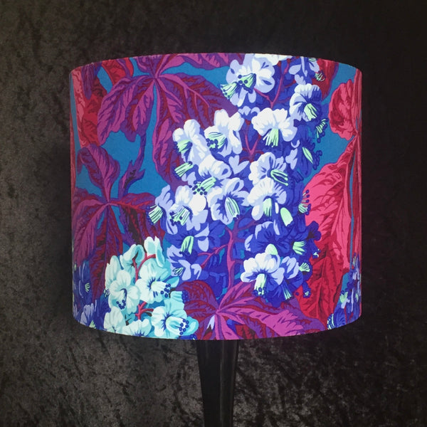 Lampshade featuring horse chestnut leaves  and flowers in blues, pinks and reds