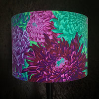 Lampshade featuring purple chrysanthemum flowers on a bright green background