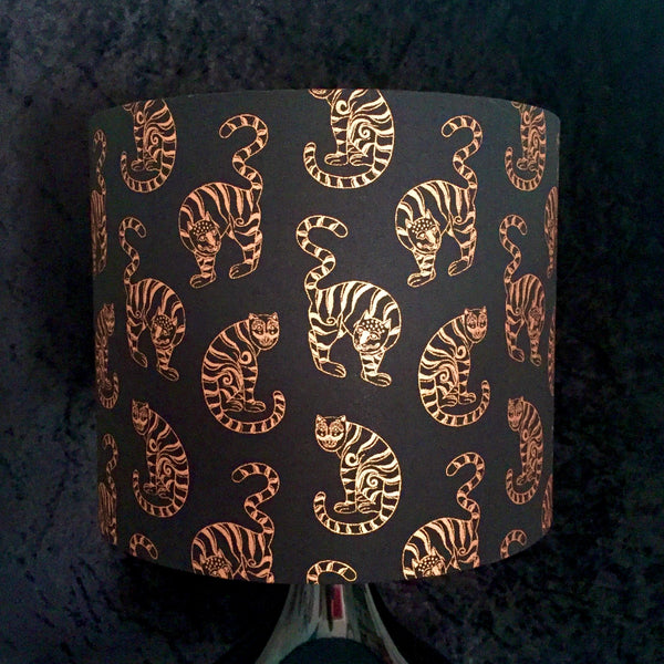 Black lampshade with metallic copper cats