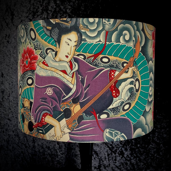 Lampshade featuring geisha playing a stringed instrument