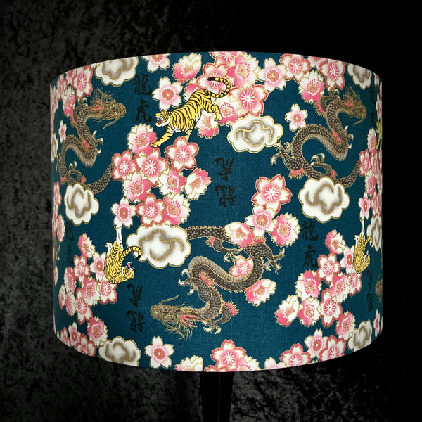 Lampshade with dragons, tigers and cherry blossom with gold metallic highlights on a teal background