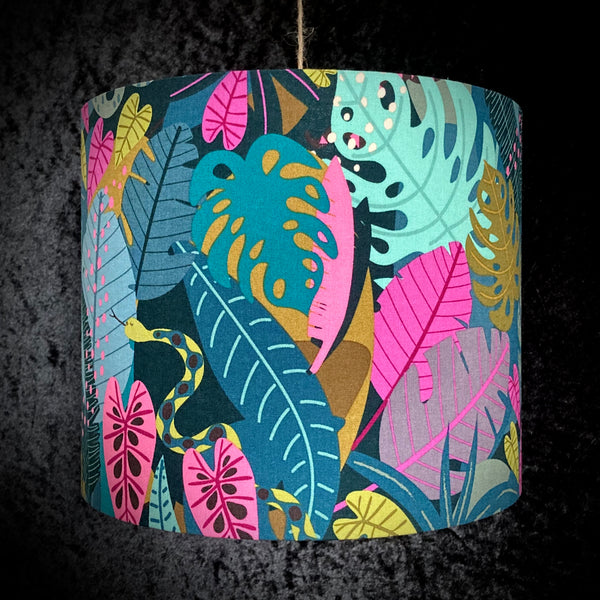 Lampshade with teal, pink and mustard foliage and snake