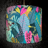 Lampshade with teal, pink and mustard jungle foliage and snake
