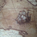 Close up image of ship on antique map fabric