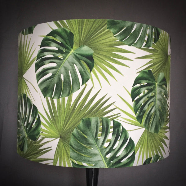 Lampshade with tropical leaves in green on a white background