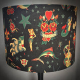 Vintage tattoo designs on black lampshade