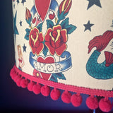 Tattoo flash lampshade with pompom trim