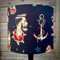 Lampshade featuring nautical-themed tattoo designs