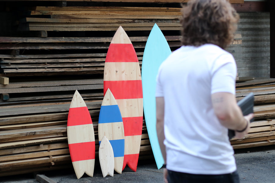 Three friends, decorative surfboards and a blueprint for the planet.