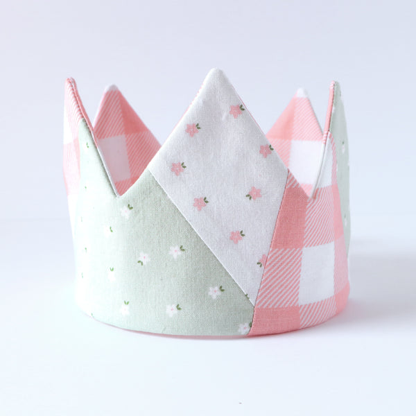 Close up of handmade crown, pink and green gingham and floral fabric