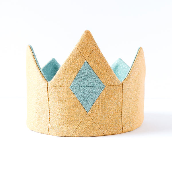 Close up of gold kids play crown, with blue quilted jewel handmade for kids birthday