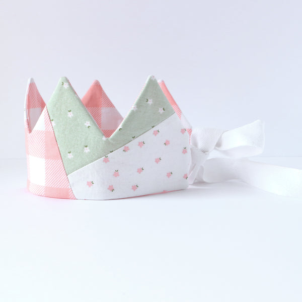 Side view of pink gingham, green floral and white floral quilted kids crown