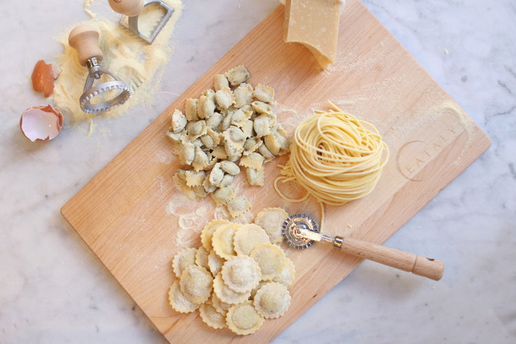 fresh pasta on a wooden board