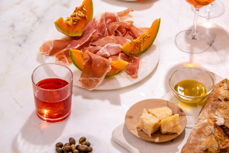 prosciutto and melon with wine and cheese