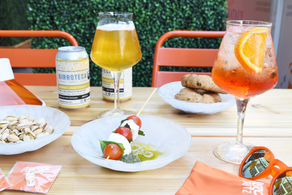 aperol spritz and beer with small bites