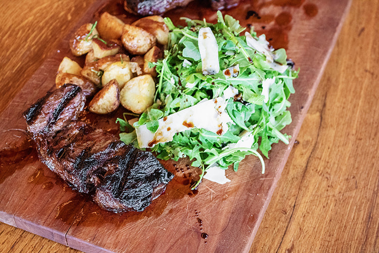 steak with salad and potatoes