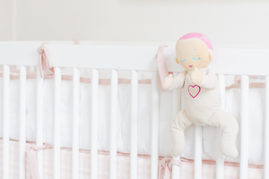 Lulla doll on crib