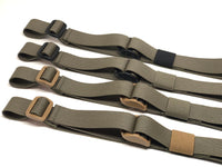 Four Ranger Green TOIM customizable quick adjust two point slings with a mixutre of ranger green, coyote brown, and black pull tabs, hardware, and elastic keepers