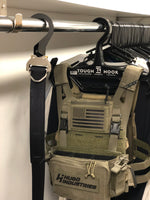 Cobra buckle belt hanging in closet with Crye SPC plate carrier hanging behind it