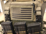 Close up of Crye SPC plate carrier with placard extenders installed