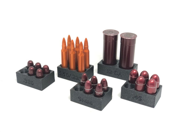 snap cap holders with 5.56, 12ga, .45, 9mm, and .380 snap caps in them