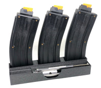 cmmg .22 lr conversion kit bolt and magazines placed in a plastic holder