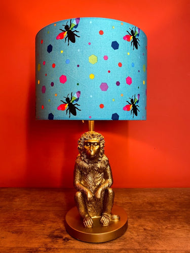 turquoise lampshade with colourful hexagons and bees