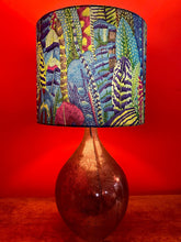 Load image into Gallery viewer, A stunning and unusual lampshade with overlapping feathers in greens, blues and purples for a lamp base or stand.