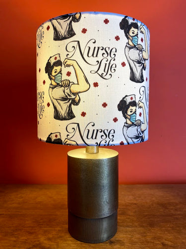 raising money for the nhs with this strong women nurse lampshade with a white background