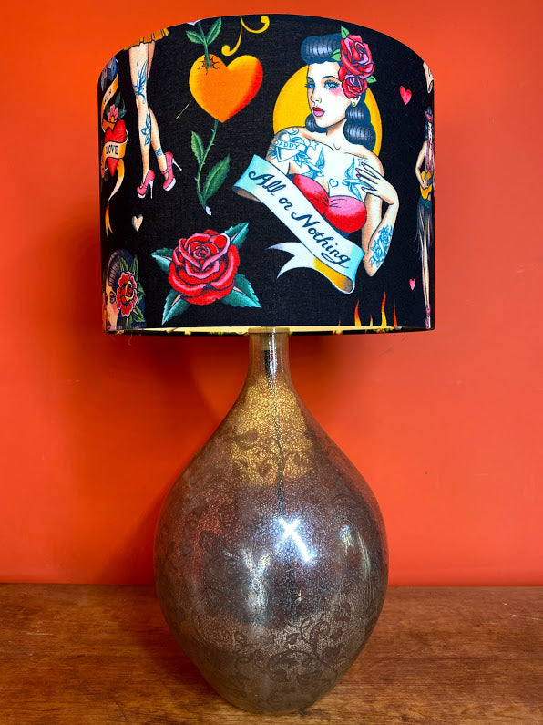 Tattooed lady lampshade with black background