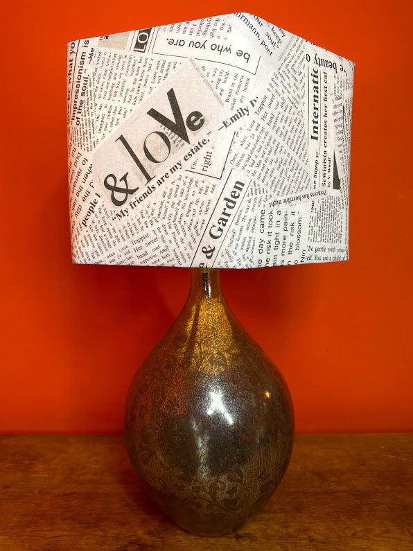 Hexagonal lampshade with newspaper print