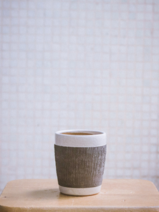 cup with black holder decoration The Broke Potter handmade ceramics made in Hong Kong sustainable clay