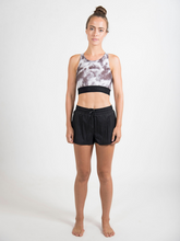Load image into Gallery viewer, Maha Yogi the runner short in black ethical activewear shop sustainable brands