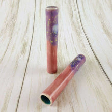 Load image into Gallery viewer, 2 Pink Skinny round pipes with purple burst decoration on mouth piece and turqouise bowl. 1 Laying on light wood surface, the other standing upright on it's end