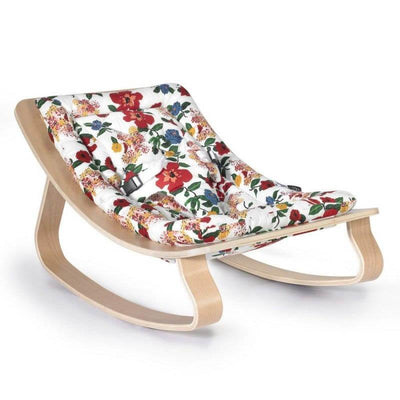 This adorable baby rocker from Charlie Crane will let you keep your little one close while still being comfortably settled. We love its original pattern!