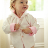 Adorable knitted jacket complimented by a classic pink or blue lining will keep your child warm in style!   100% Cotton bu a soft idea