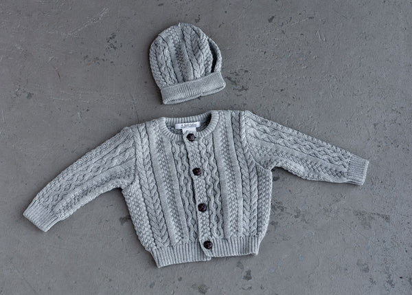 This cardigan is styled with unique stitching and buttons on the front. It comes in two colors and is perfect for all boys! 100% Cotton Machine Washable by a soft idea