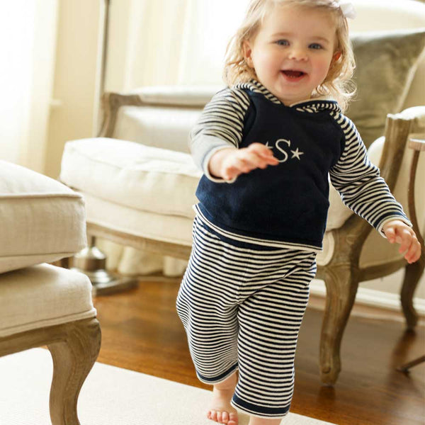 Check out one of our new arrivals! Your little one will be cuter than cute in this striped hoodie/pant set! Lightweight and versatile fabric and featuring a convenient zipper back. Front of hoodie is also great for adding personalized text and/or images!  100% Cotton by a soft idea